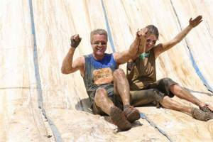 This is not our first run together. Here we are sliding down the finish of the Ruckus obstacle mud run!